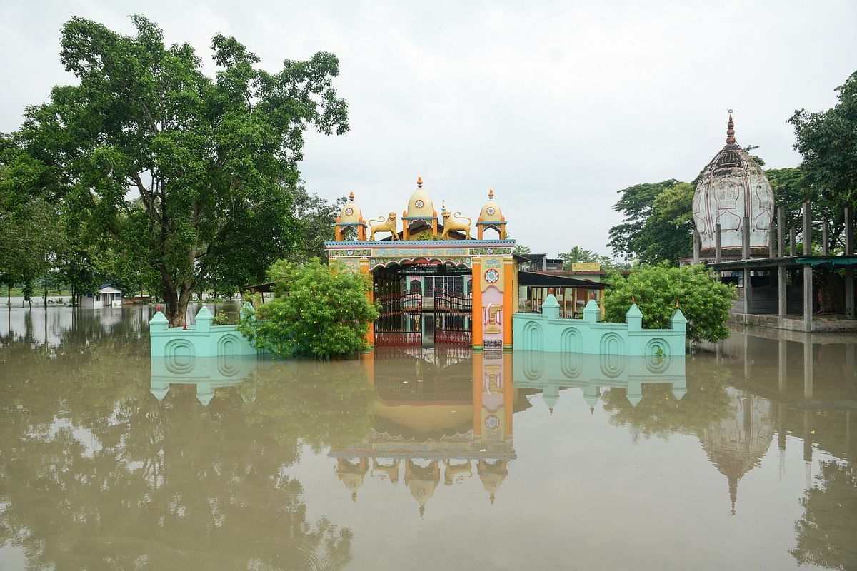 A temple is seen half submerged under flood waters, following heavy monsoon rain, in Kamrup district, Friday, 12 July.