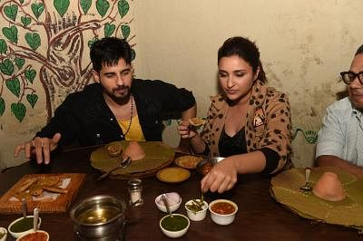 "Lucknow: Actors Sidharth Malhotra and Parineeti Chopra enjoy food at a restaurant during their visit to Lucknow to promote their film ""Jabariya Jodi"", on July 27, 2019. (Photo: IANS)"