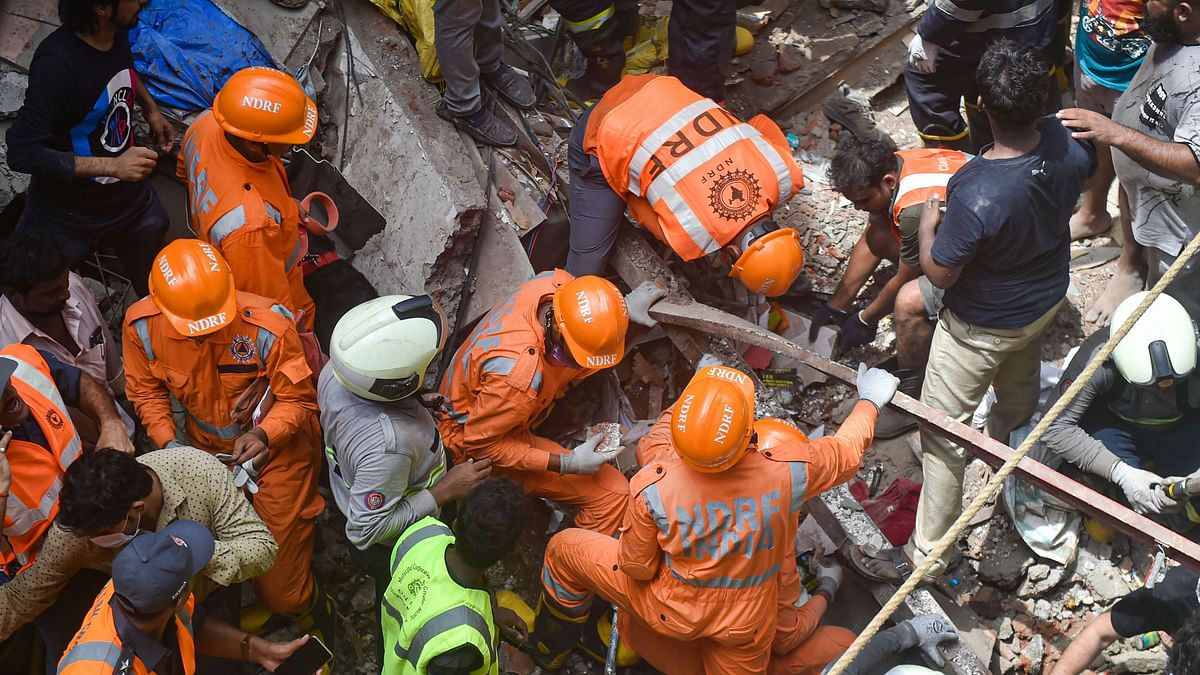 Fire Brigade and NDRF personnel carry out rescue works after the collapse of the four-storey Kesarbai building at Dongri in Mumbai on 16 July 2019.
