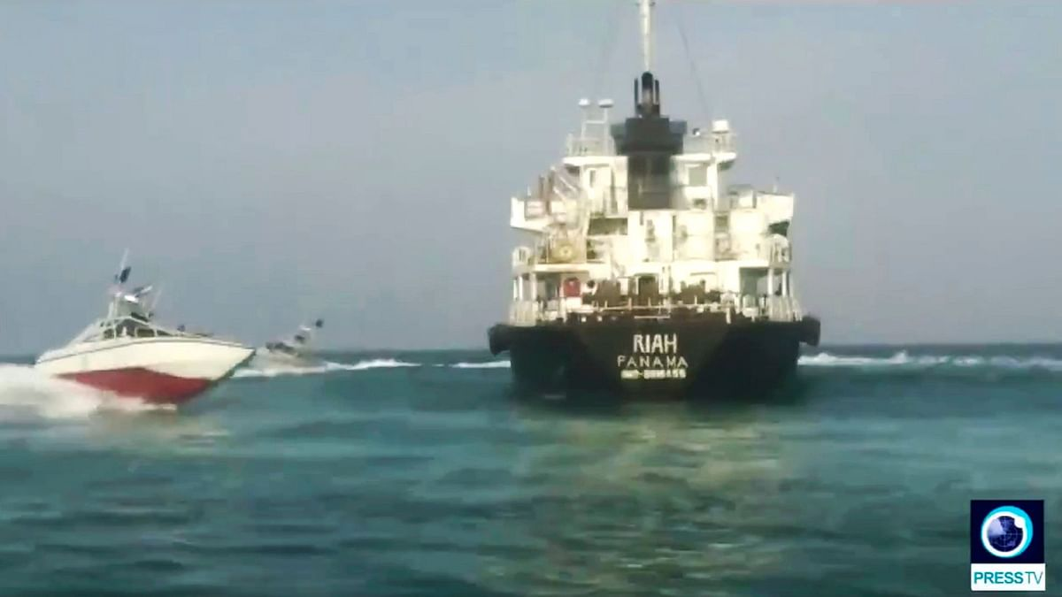 Panamanian-flagged oil tanker MT Riah surrounded by Iranian Revolutionary Guard vessels.