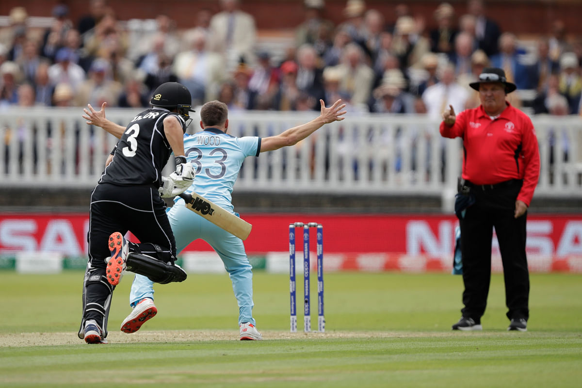 England's Mark Wood successfully appeals for the wicket of New Zealand's Ross Taylor, left, LBW during the Cricket World Cup final match between England and New Zealand at Lord's.