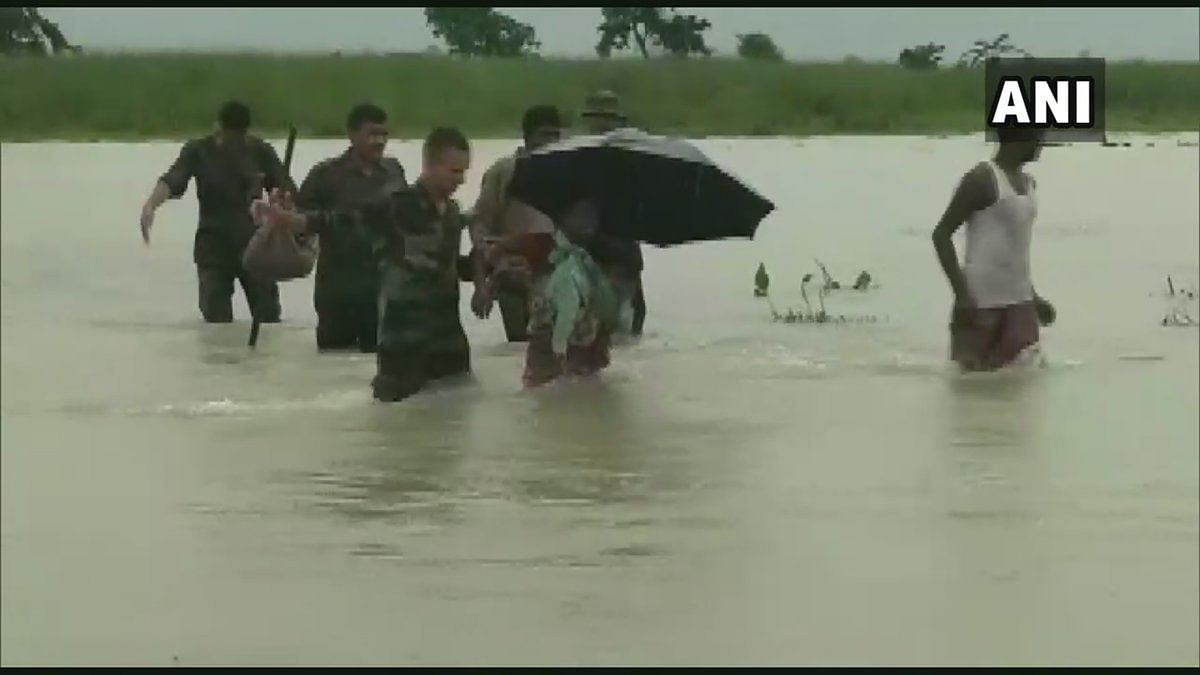 Jawans of the  Indian Army rescued locals who were stuck in the flood in the Runikhata area of Chirang district in Assam.