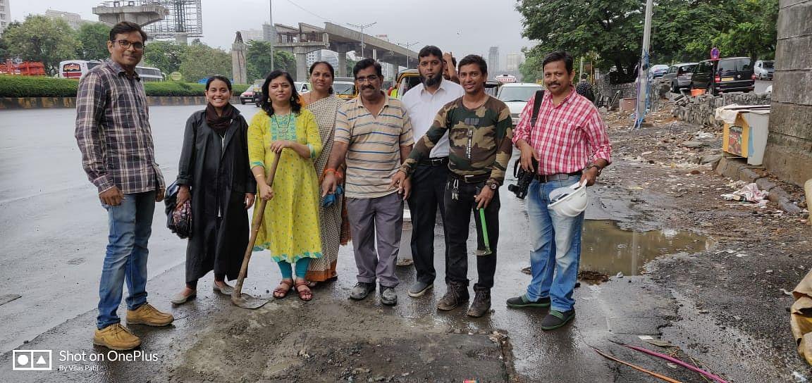 Filling potholes in West Goregaon.Pothole filling by citizen Alert #PotholeWarriors Team Mumbai 30june2019 on Goregaon East WEH