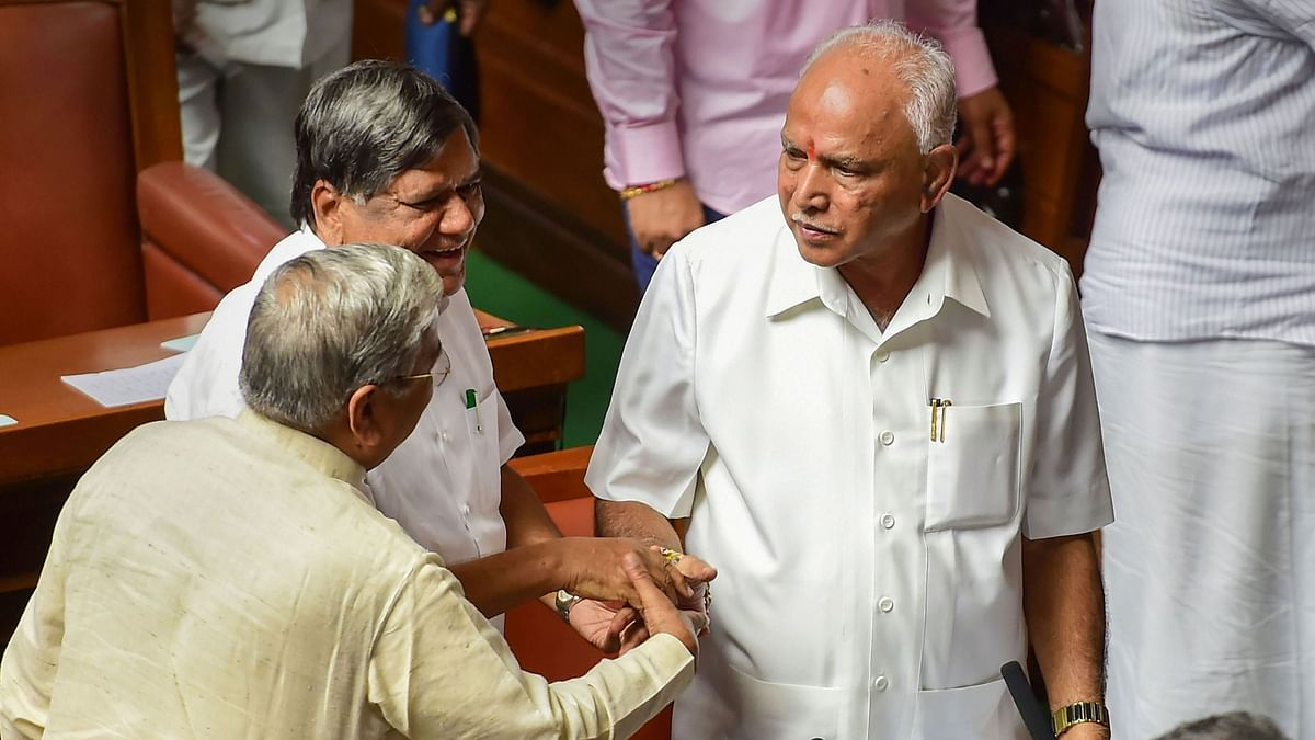 Karnataka CM BS Yediyurappa shakes hands with his party leaders and MLAs after proving majority in the Assembly on 29 July.