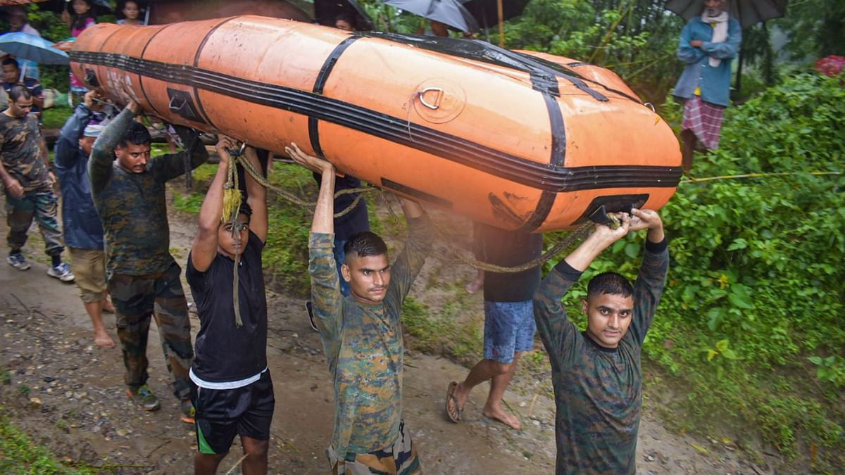 The Indian Army carry out a rescue operation in the flooded village of Baksa district in Assam.