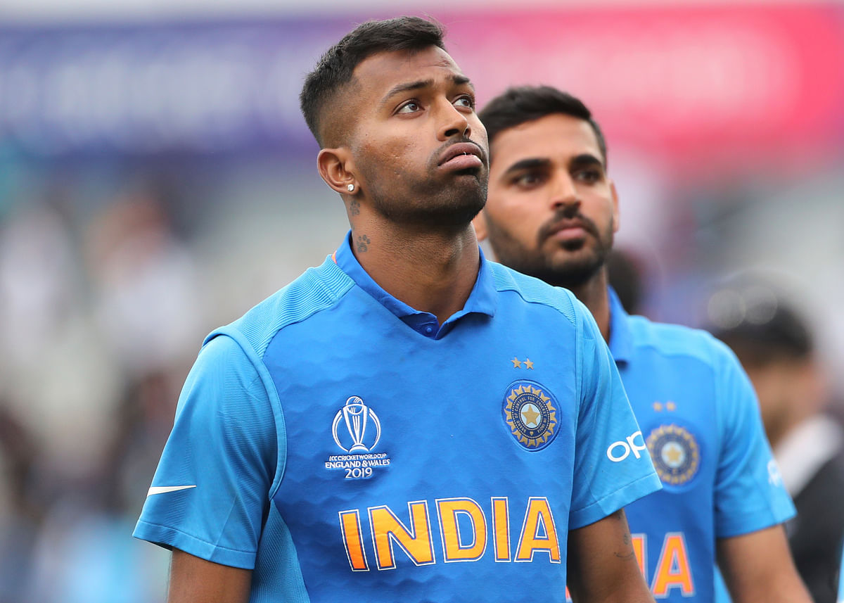 India's Hardik Pandya, left, reacts after their loss in the Cricket World Cup semi-final match against New Zealand at Old Trafford in Manchester, England, Wednesday, July 10, 2019.
