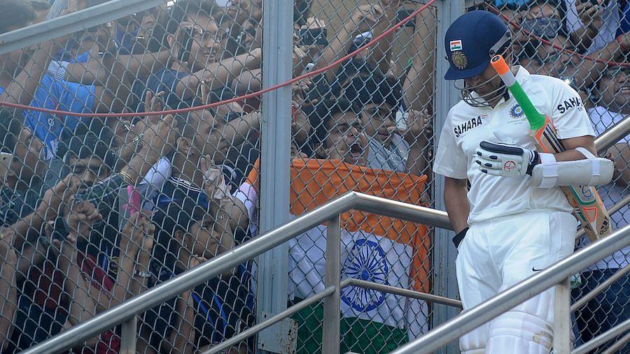 Sachin Tendulkar walks out to bat.