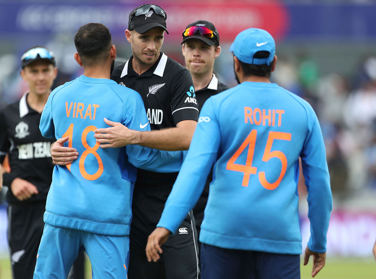 India's captain Virat Kohli, second left, hugs to congratulate New Zealand's Tim Southee on their win in the Cricket World Cup semi-final match between India and New Zealand at Old Trafford in Manchester, England, Wednesday, July 10, 2019.