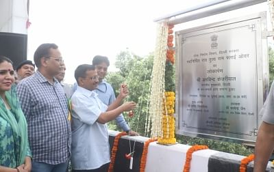 New Delhi: Delhi Chief Minister Arvind Kejriwal and Public Works Department Minister Satyendra Kumar Jain unveil the plaque to inaugurate the newly constructed Rao Tula Ram (RTR) Flyover at Outer Ring Road near Munirka in New Delhi, on July 16, 2019. (Photo: IANS)