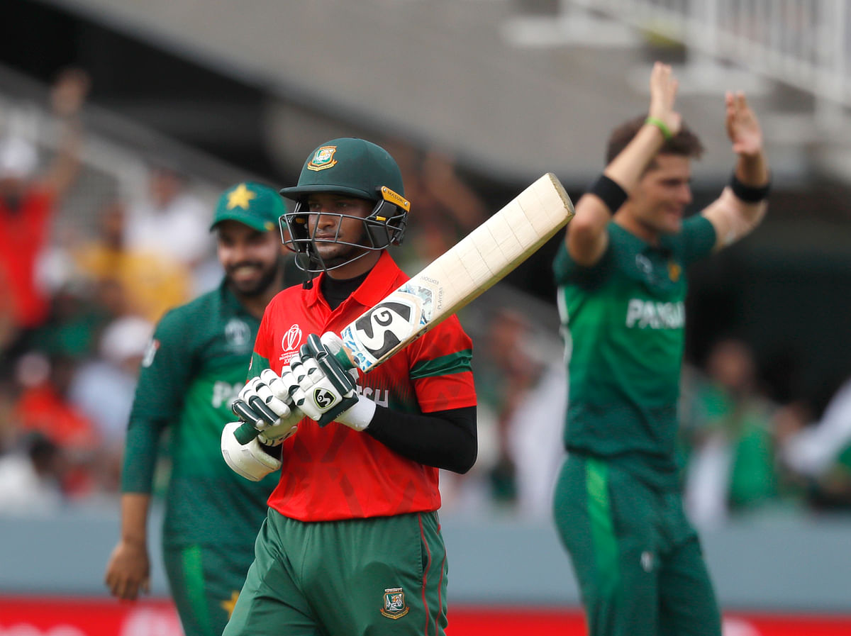 Bangladesh's Shakib Al Hasan walks off the pitch after being given out caught behind off the bowling of Pakistan's Shaheen Afridi during the Cricket World Cup match.