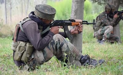 Pulwama: Soldiers take position during a gun fight between security forces and militants in which four people were killed in Jammu and Kashmir