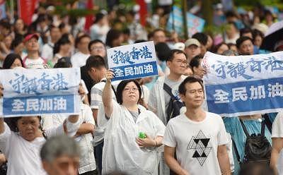"""HONG KONG, July 20, 2019 (Xinhua) -- Local residents hold banners during the """"Safeguard Hong Kong""""  massive rally at Tamar Park in south China"""
