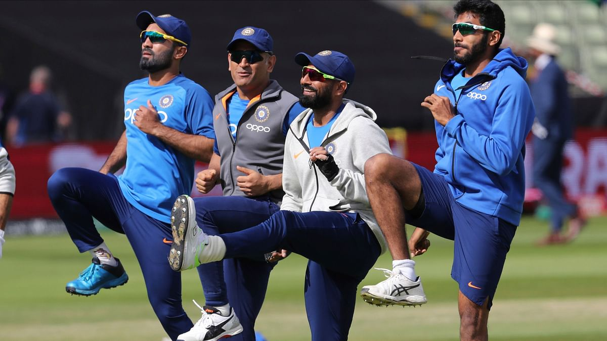 Dinesh Karthik warms up with his team-mates ahead of the match against Bangladesh.