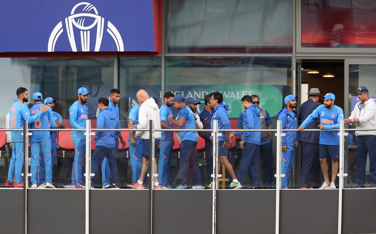 Indian cricketers react after their team lost the Cricket World Cup semifinal match between India and New Zealand at Old Trafford in Manchester, Wednesday, July 10, 2019.