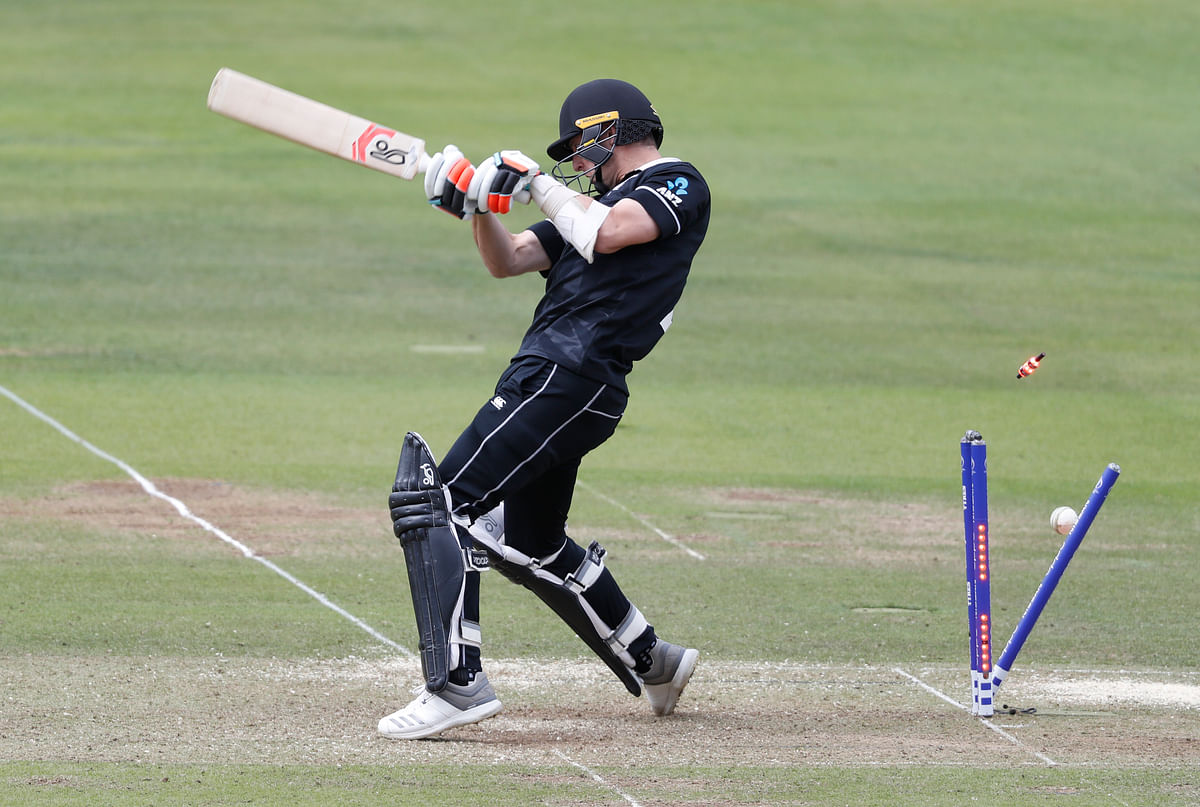 New Zealand's Matt Henry is clean bowled by England's Jofra Archer during the Cricket World Cup final.