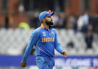 Manchester: Indian skipper Virat Kohli leaves the field after rains interrupt the 1st Semi-final match of 2019 World Cup between India and New Zealand at Old Trafford in Manchester, England on July 9, 2019. (Photo: Surjeet Kumar/IANS)