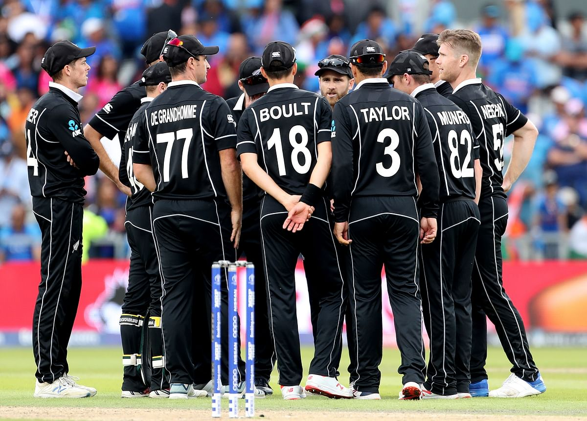 New Zealand players celebrate their win over India in the Cricket World Cup semi-final match at Old Trafford in Manchester, England, Wednesday, July 10, 2019.