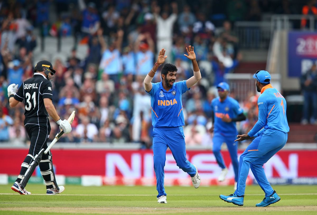 Jasprit Bumrah celebrates the wicket of New Zealand's Martin Guptill in the 2019 ICC World Cup semi-final at Old Trafford.