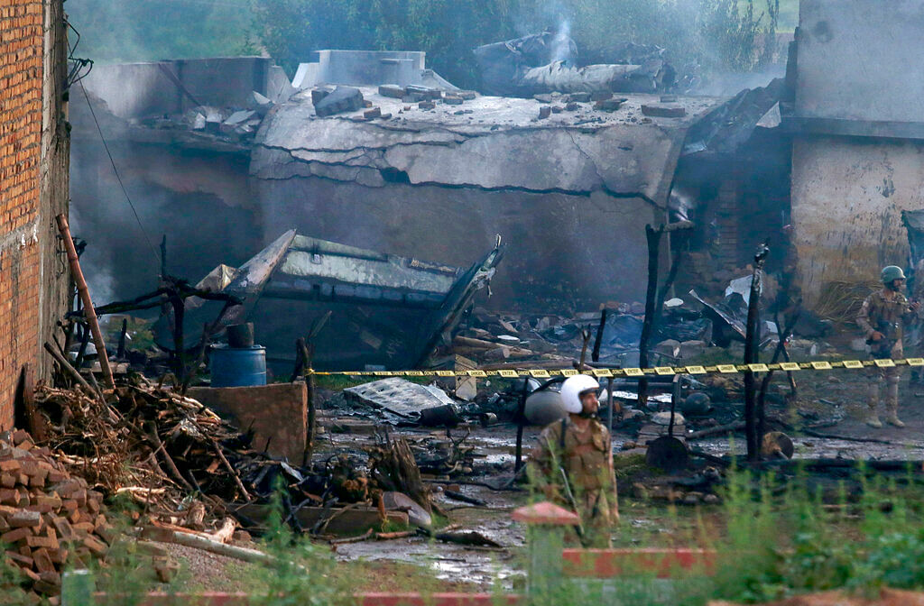 Pakistan army soldier stands guard the site of a plane crash in Rawalpindi, Pakistan, ON 30 July 2019.