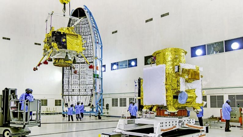 Officials carry out the hoisting of the Vikram Lander during the integration of Chandrayaan-2.