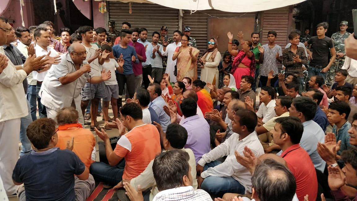 People outside temple demanding action against the culprits.