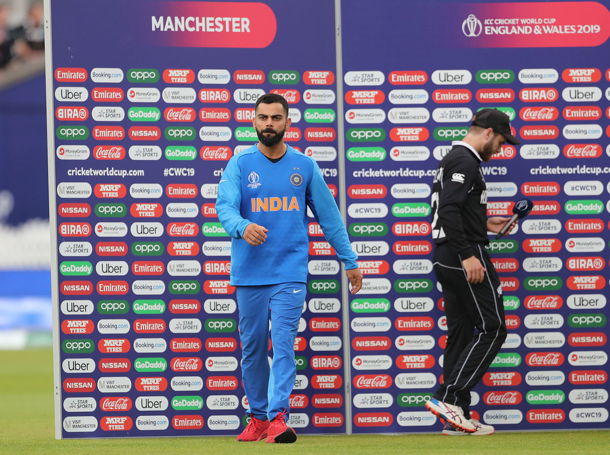 India's captain Virat Kohli, left, walks away from New Zealand's captain Kane Williamson, right, at the presentation ceremony after India's loss in the Cricket World Cup semi-final match at Old Trafford in Manchester, England, Wednesday, July 10, 2019.