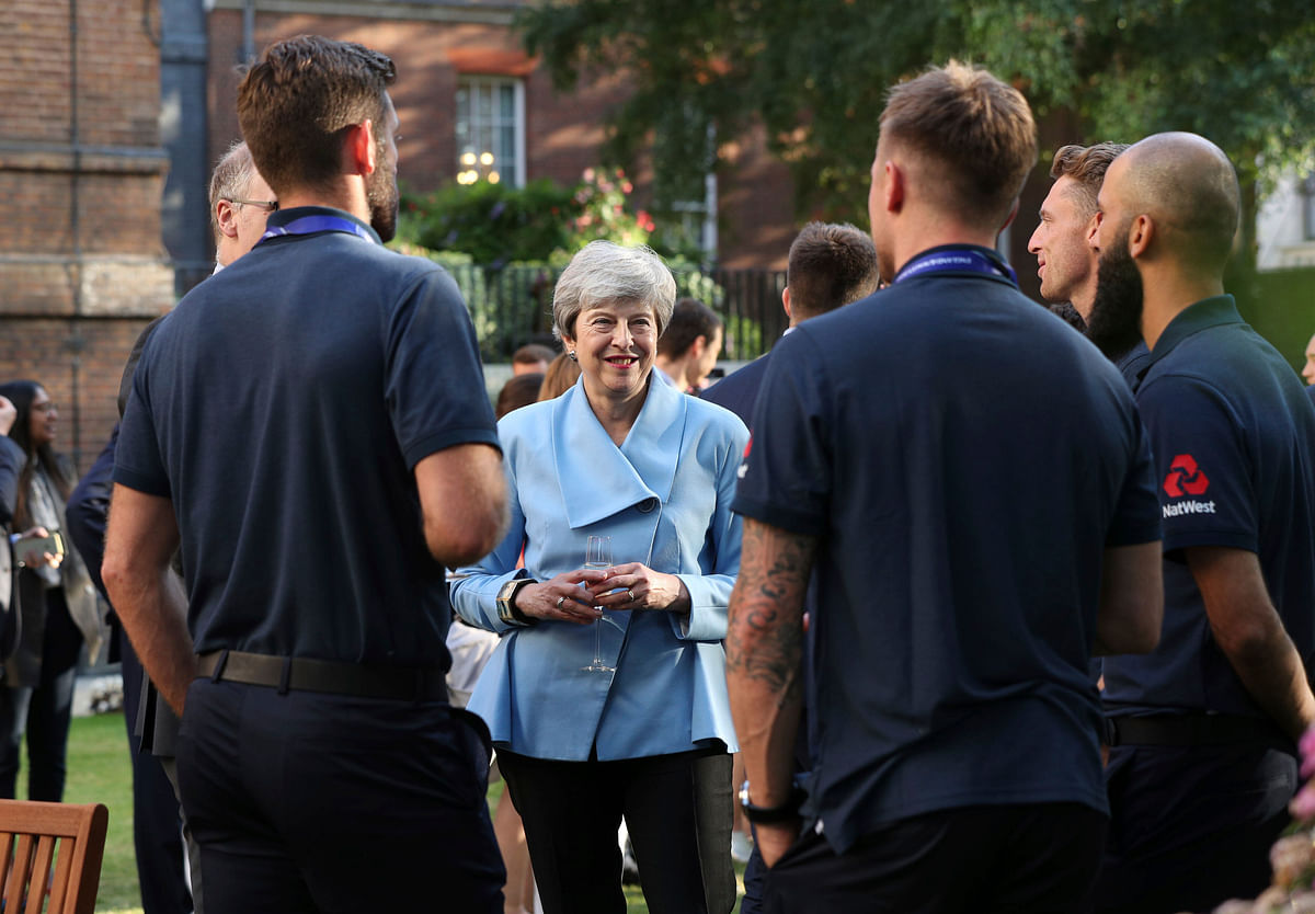 Britain's Prime Minister Theresa May with the England cricket team after their win in the ICC World Cup 2019.