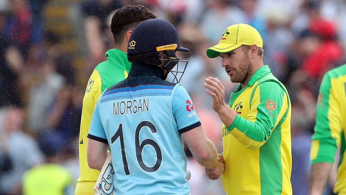 England's captain Eoin Morgan, left, shakes hands with Australia's captain Aaron Finch, right, after winning the Cricket World Cup semi-final match between England and Australia at Edgbaston.