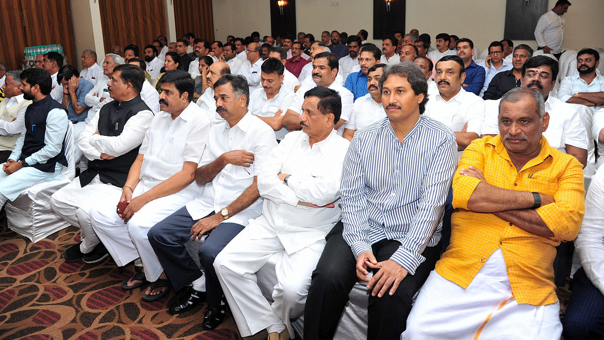 Karnataka BJP MLAs during a meeting on the eve of the trust vote in Bengaluru on 28 July 2019.
