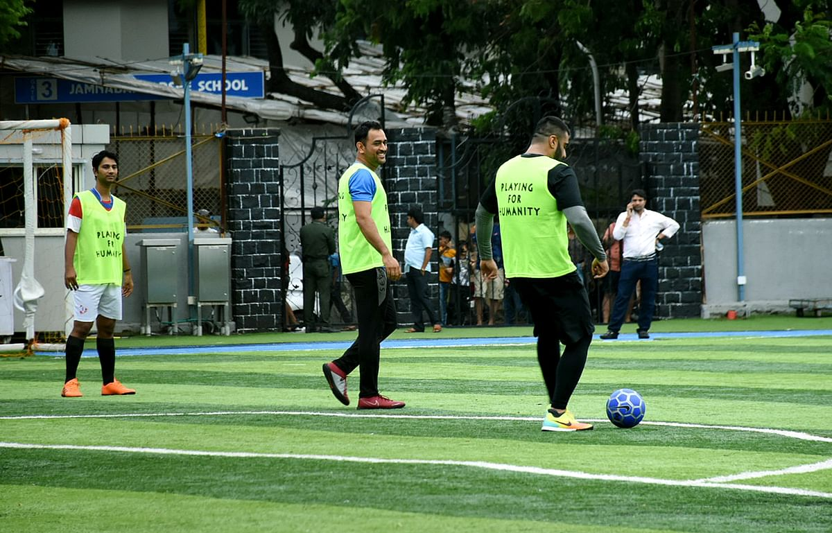 Mahendra Singh Dhoni with Arjun Kapoor during a football practice session in Mumbai.