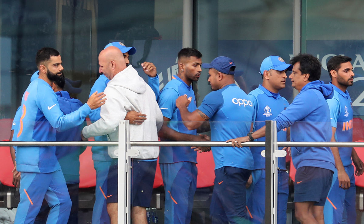 Indian cricketers greet each other after their team lost the Cricket World Cup semifinal match between India and New Zealand at Old Trafford in Manchester, Wednesday, July 10, 2019.