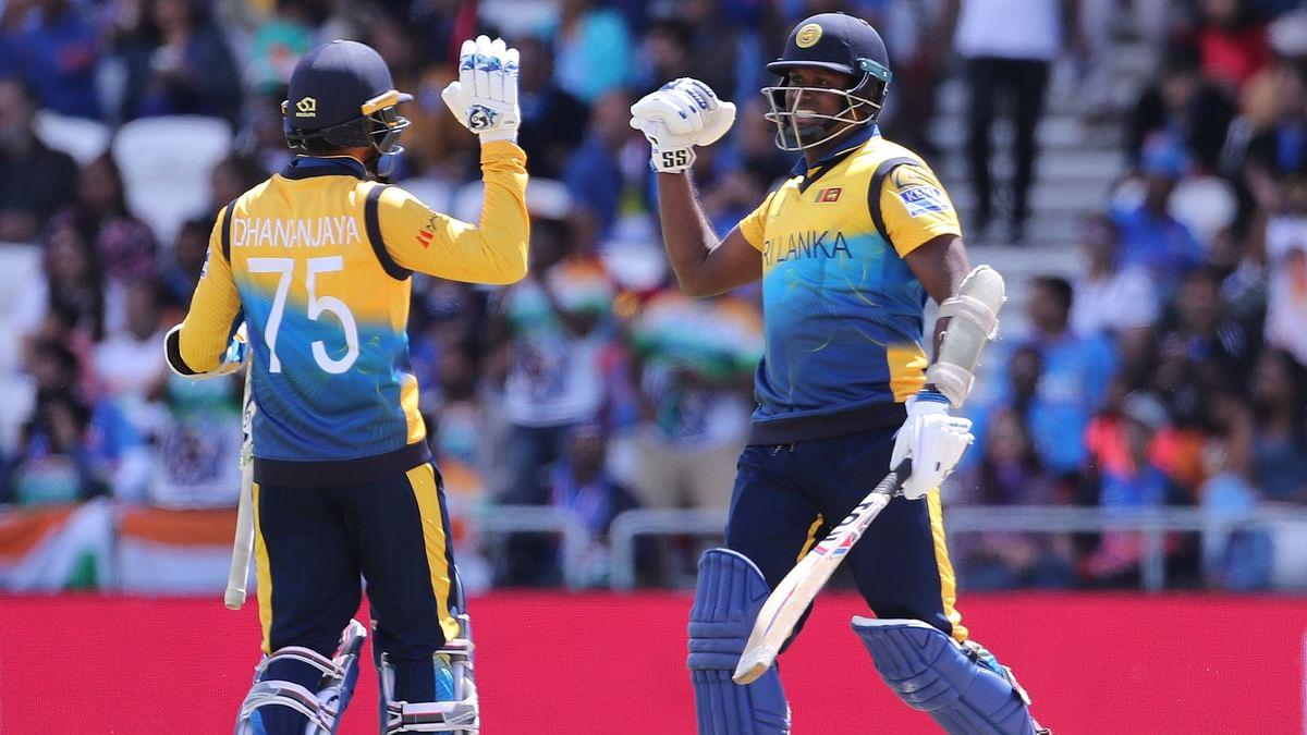 Sri Lanka's Angelo Mathews (right) celebrates with teammate Dhananjaya de Silva after scoring a century during the Cricket World Cup match.