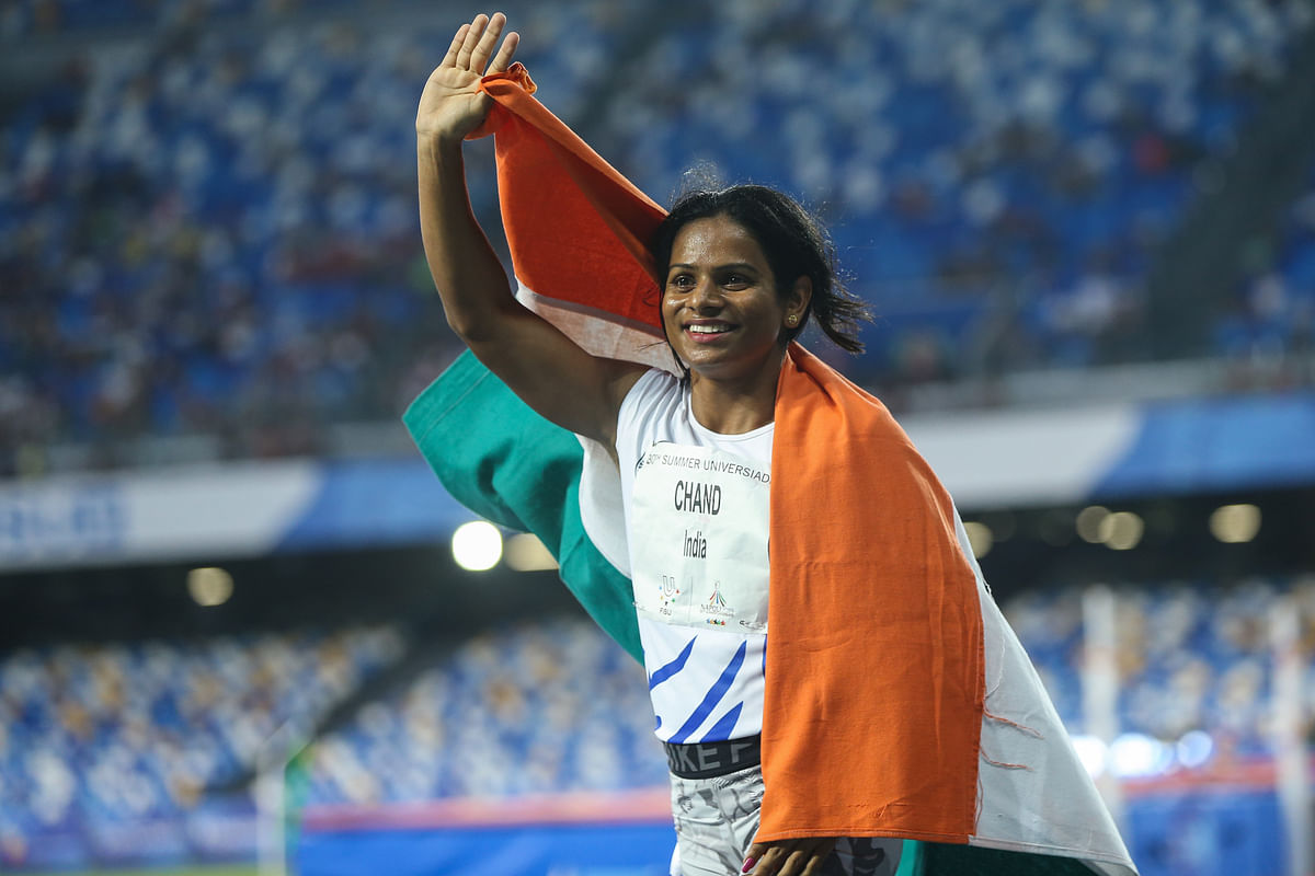 Dutee Chand  celebrates her victory after the Women's 100m Final at the 30th Summer Universiade in Naples.