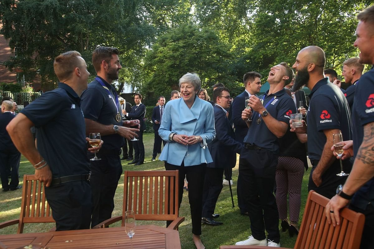 Britain's Prime Minister Theresa May at her residence with the England cricket team after their win in the ICC World Cup 2019.