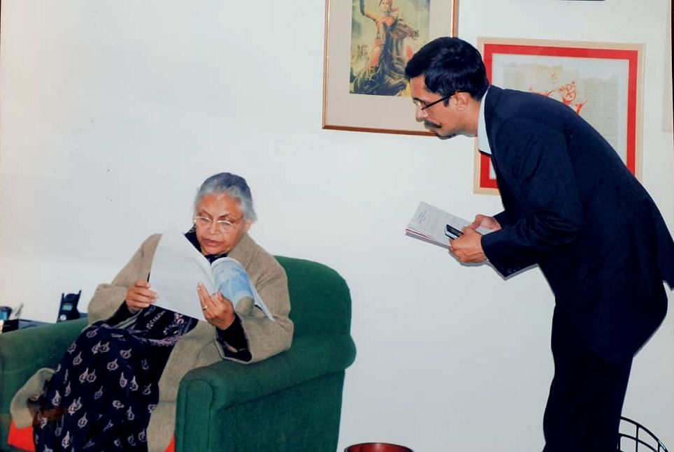 Sheila Dikshit and Pawan Khera during her tenure as the chief minister of Delhi.