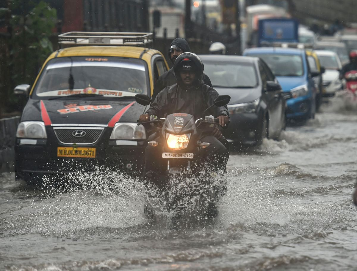 Vehicles wade through a waterlogged street following heavy monsoon rain in Mumbai.