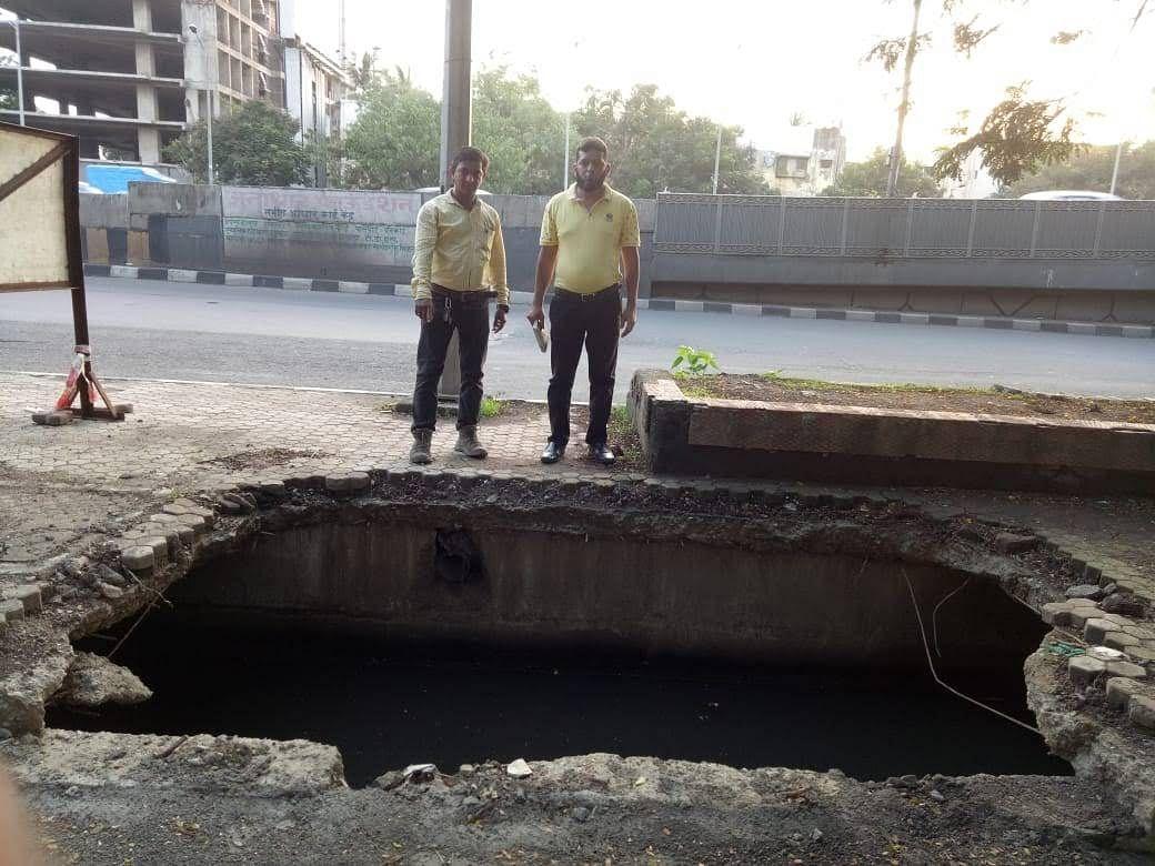 A sunken manhole at Bandra East WeH, opposite Gandhi Nagar building.