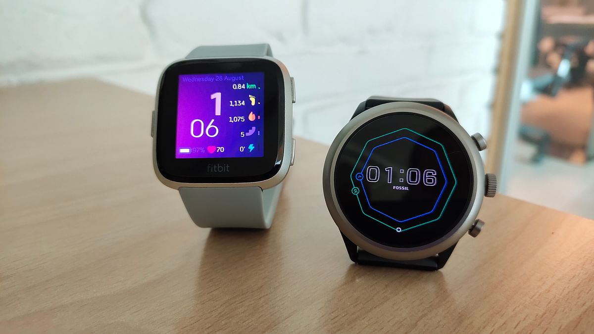 The Fitbit Versa (left) and the Fossil Sport.