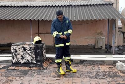 Chennai: A firefighter at the Harbour Telephone Exchange of the Bharat Sanchar Nigam Ltd (BSNL) where a fire broke out affecting mobile, landline and broadband connectivity in the area, in Chennai on Aug 1, 2019. (Photo: IANS)