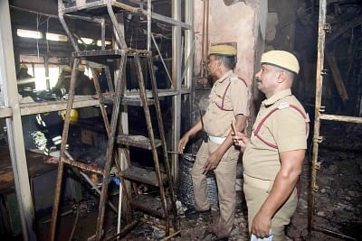 Chennai: Police personnel at the Harbour Telephone Exchange of the Bharat Sanchar Nigam Ltd (BSNL) where a fire broke out affecting mobile, landline and broadband connectivity in the area, in Chennai on Aug 1, 2019. (Photo: IANS)