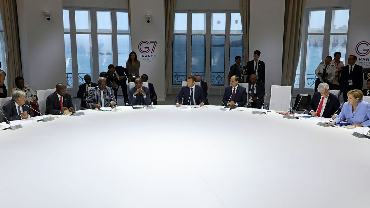 Trump left an empty chair as global power brokers debated Monday how to help the fire-stricken Amazon and reduce carbon emissions.