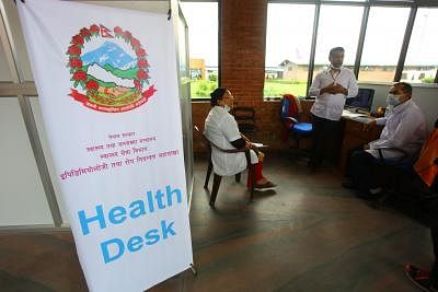 KATHMANDU, Aug. 20, 2014 (Xinhua) -- Doctors work at a health desk at Tribhuwan International Airport in view of the outbreak of Ebola Virus Disease in West African nations in Kathmandu, Nepal, Aug. 20, 2014. (Xinhua/Sunil Sharma/IANS) ****Authorized by ytfs****