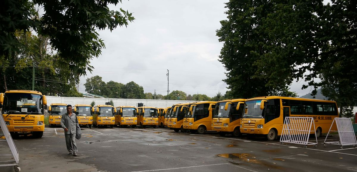 School buses are parked inside the premises of a deserted school compound in Srinagar.