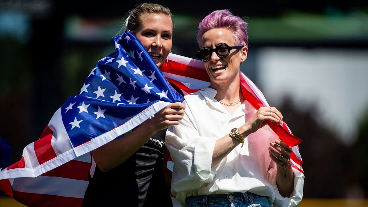 File picture of Reign FC midfielder Allie Long (left) and forward Megan Rapinoe