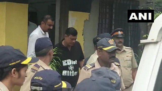 "MNS leader Sandeep Deshpande, wearing a tee shirt with ""EDiot Hitler"" emblasoned on it, taken into custody by police."