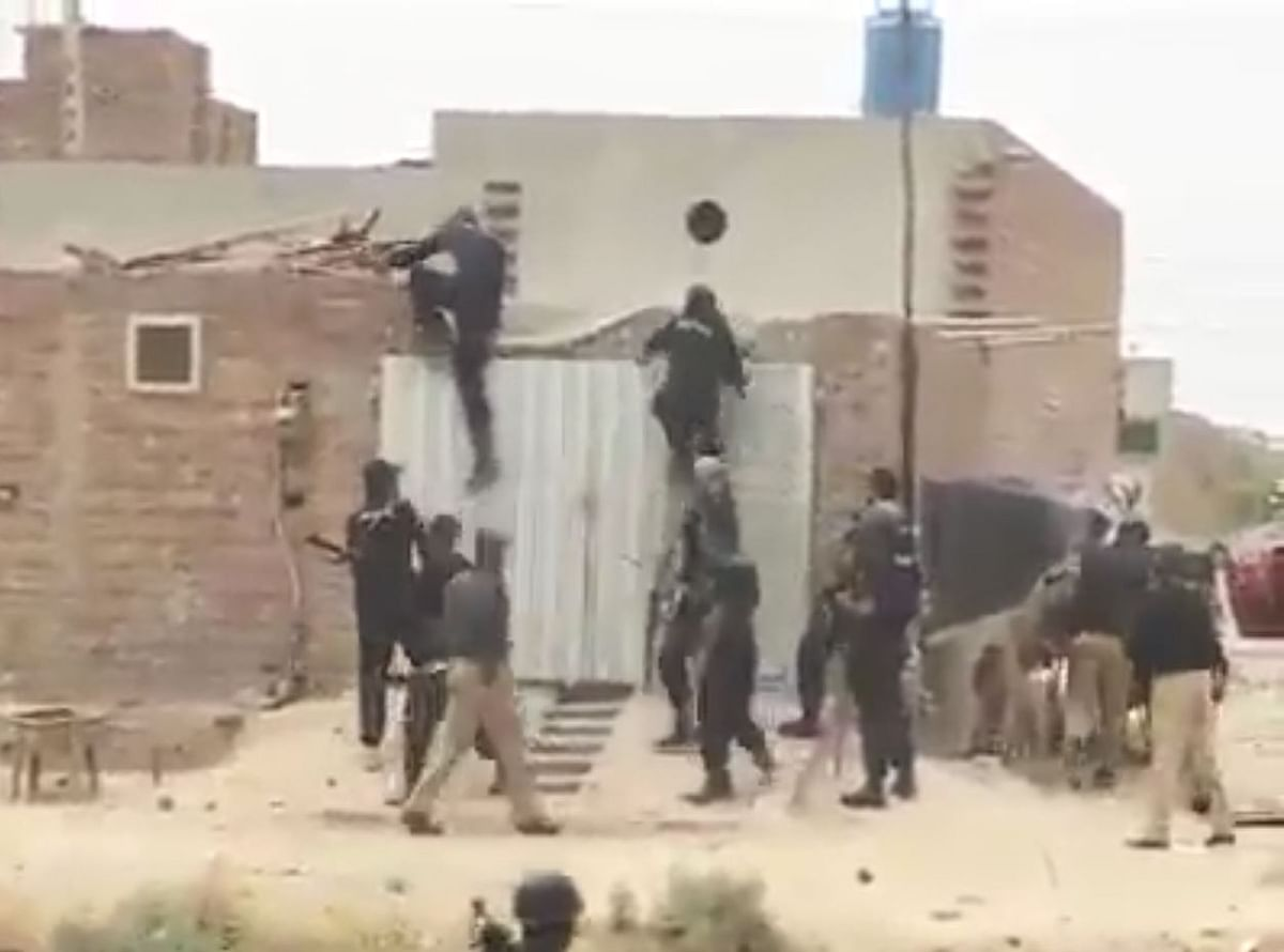 The men in the video, equipped with laathis (sticks) and guns, are seen dragging people out of their houses as women are left behind crying for help.