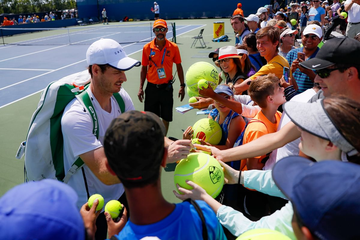 Andy Murray signs autographs after practicing at the Western & Southern Open tennis tournament, Sunday, Sunday, Aug. 11, 2019, in Mason, Ohio.