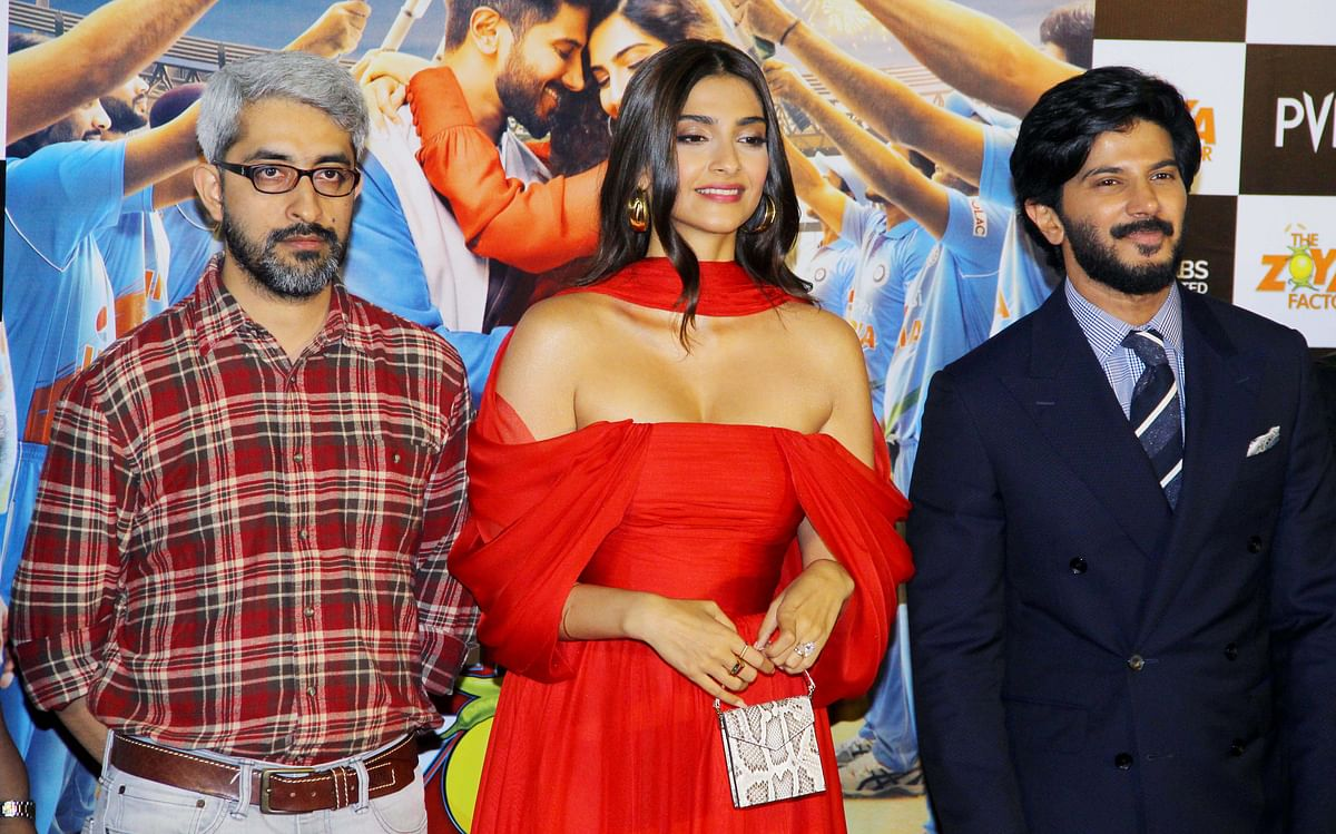 Director Abhishek Sharma with actors Sonam K Ahuja and Dulquer Salmaan at <i>The Zoya Factor </i>trailer launch.