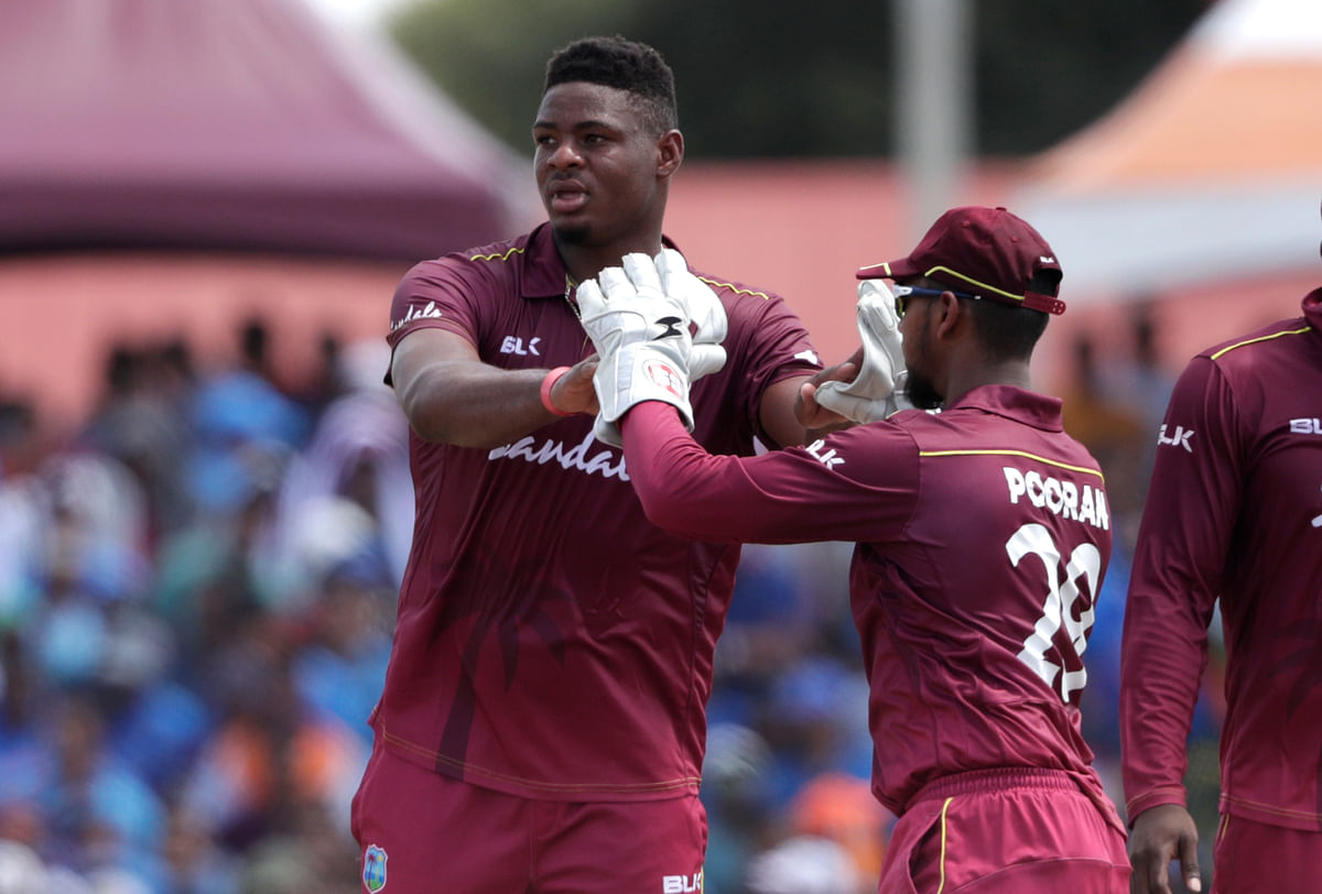 West Indies' Keemo Paul, left, is congratulated by Nicholas Pooran after taking the wicket of India's Rishabh Pant during a Twenty20 international in India.