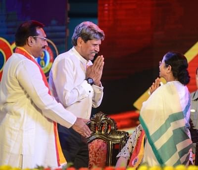 Kolkata: West Bengal Chief Minister Mamata Banerjee and former cricketer Kapil Dev during the 100th Anniversary celebrations of East Bengal Club, in Kolkata on Aug 1, 2019. (Photo: IANS)